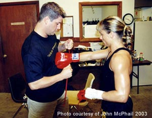 Trish getting her gloves put on